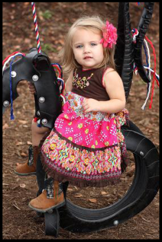Cow girl riding the horse swings!